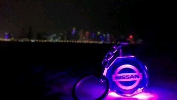 Nissan multicoloured glass keychain