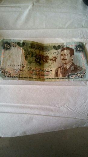 عملة صدام حسين قديم