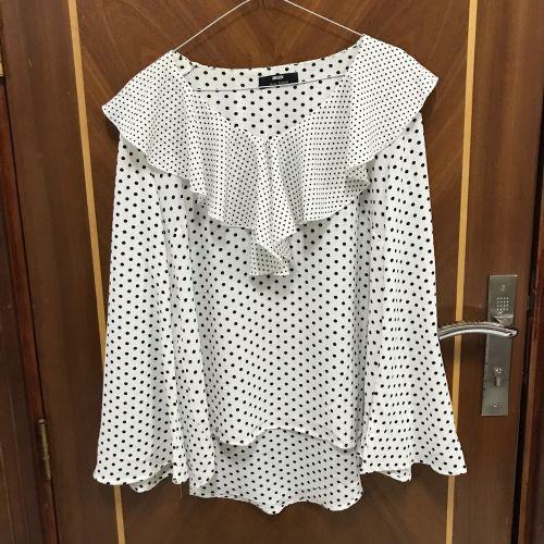 Polka dot ruffled blouse