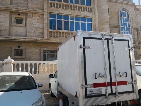 Isuzu pickup with fridge